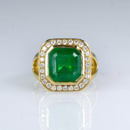 4.82ct Colombian Emerald Statement Ring with Diamond Halo in 18K Gold