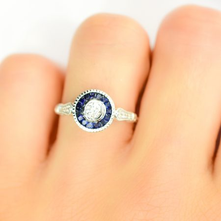 Diamond Ring with Sapphire Halo in 18K Gold