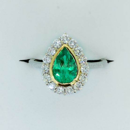 Bezel Set Emerald in a Diamond Halo Ring in 18K Gold - 1982329