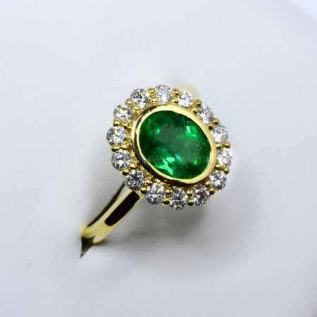 Oval Cut Colombian Emerald and Diamond Ring in 18K Gold