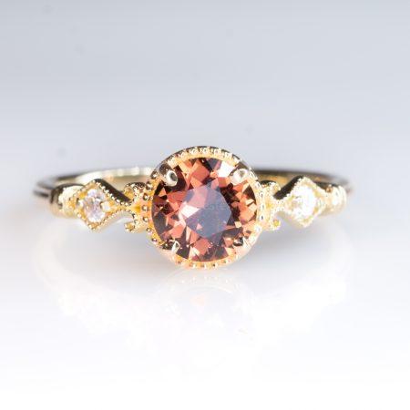 Padparadscha Saphire and Diamonds Ring